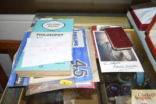 An autographed book and contents; signed photograp