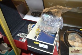 Three boxes of various costume jewellery