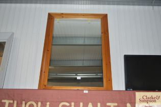 A large pine framed mirror