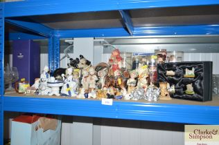 A quantity of souvenir dolls, Wade Whimsies etc