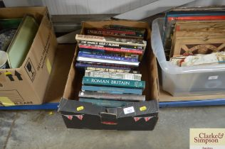 A box of various military and aircraft books