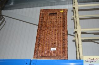 A wicker linen basket