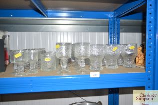 A quantity of drinking glasses