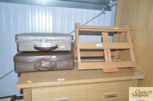 A small artists easel together with two small case