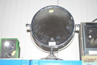 A swing frame make-up mirror