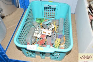 A plastic crate containing various Diecast toys to