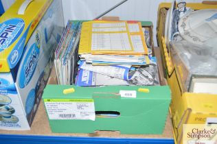 A box containing various Speedway programmes