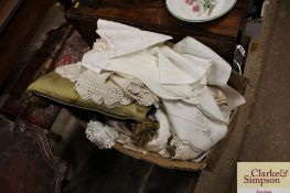 A box of various linen and lace