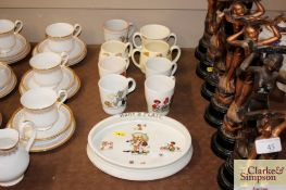 A 1930's baby's plate; and eight children's mugs