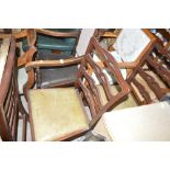A set of four mahogany ladder back dining chairs