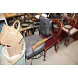 A Venus classic swivel black upholstered chair