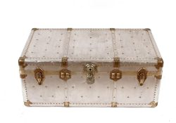 A polished metal aviation style large trunk, flank