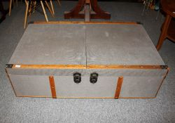 A coffee table in the form of a large vintage style trun
