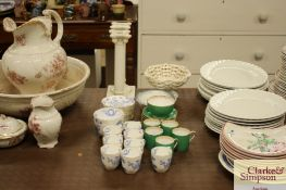 Eight Royal Worcester coffee cups and saucers; and