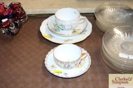 A Herend cup, saucer and matching plate; a Dresden