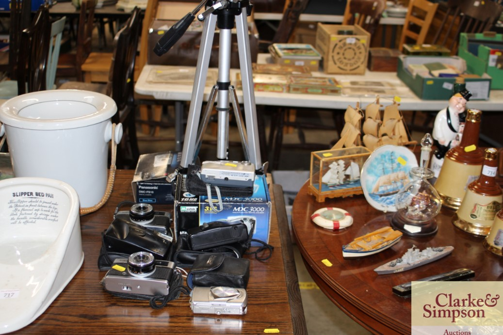 A quantity of various cameras to include Olympus,