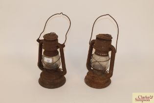 """Two small oil lamps, one named """"Gremlin"""""""