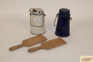Two small enamel cream jugs and a pair of wooden