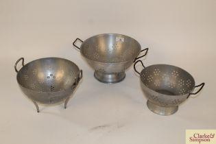 Three vintage colanders