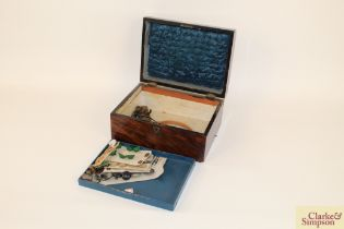 A Victorian rosewood sewing box with brass carryin