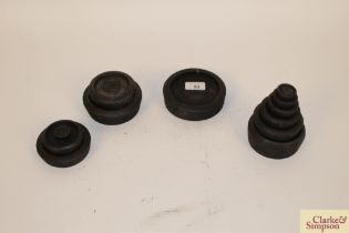 A collection of various iron shop scale weights
