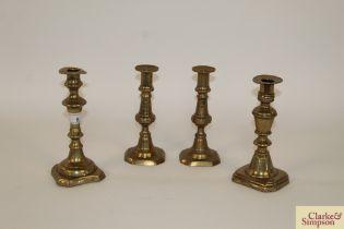 "A pair of antique brass candlesticks 7"" high and"