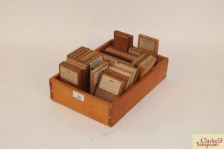 A box containing a quantity of wood specimens, som