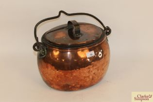 An antique copper cauldron shaped boiling pan with
