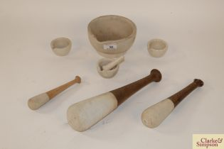 Four various mortars, one medium sized and three s
