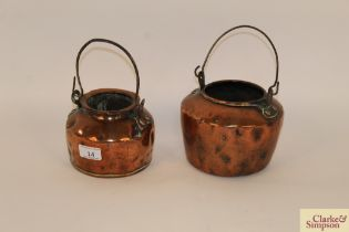 Two small Victorian copper warming jugs, each wit