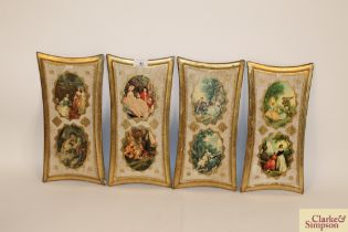 Four decorative gilt and painted panels, having ov