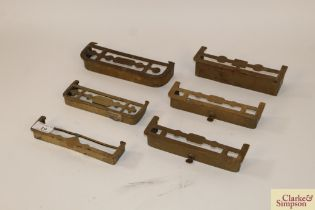 A collection of six various brass miniature salesm
