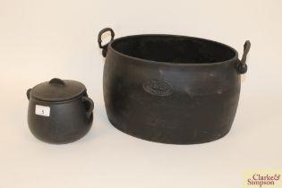 An oval cast iron cauldron / cooking pot by Pugh &