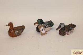 Three small model ducks