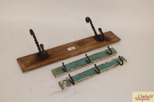 Three various sets of wooden mounted iron coat hooks
