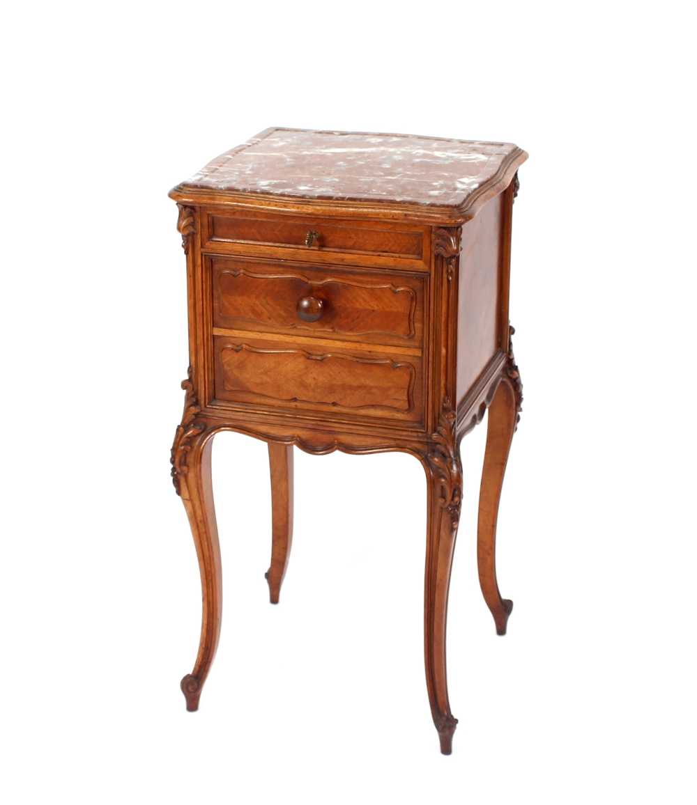 A French walnut and marble topped bedside cabinet,fitted single drawer and drop front compartment