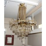 A cut glass and gilt metal tiered chandelier