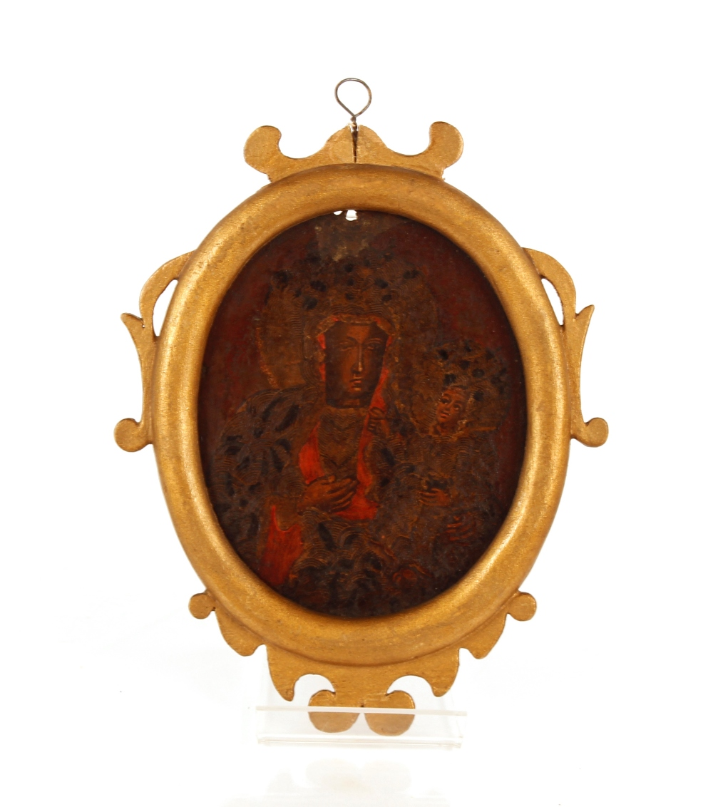 A 17th Century oil,possibly on copper sheet, double sided icon with mother and child with auroras
