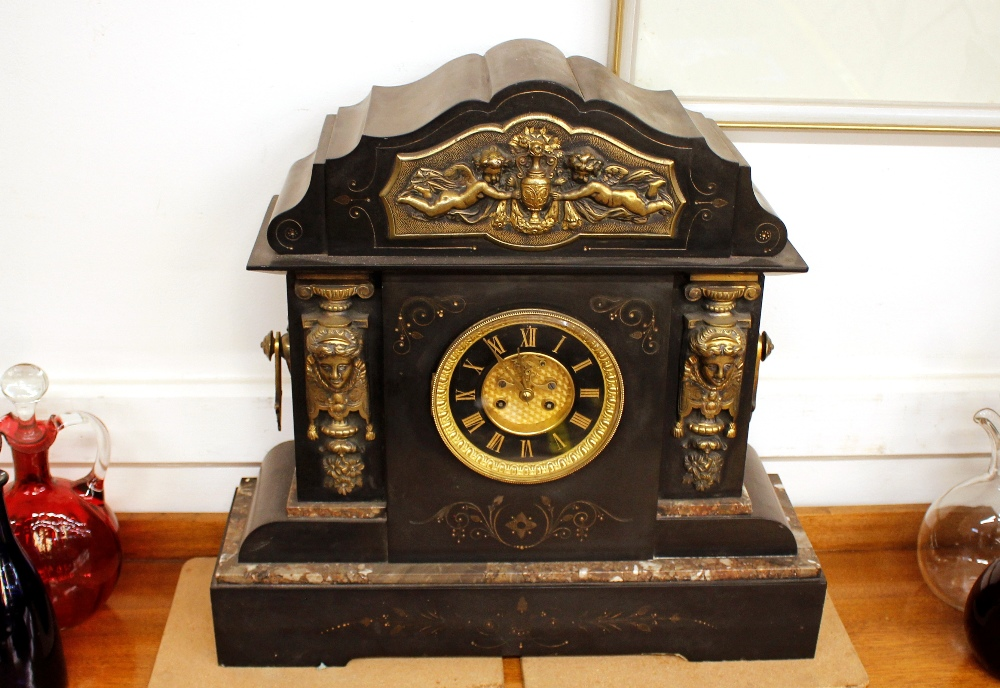 A 19th Century French marble and gilt metal mounted mantel clock,of large proportions, the