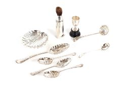 A silver shell shaped butter dish,three silver berry decorated teaspoons; a similar dessert