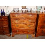 A 19th Century mahogany chest,of four long graduated drawers raised on bracket feet, 95cm wide