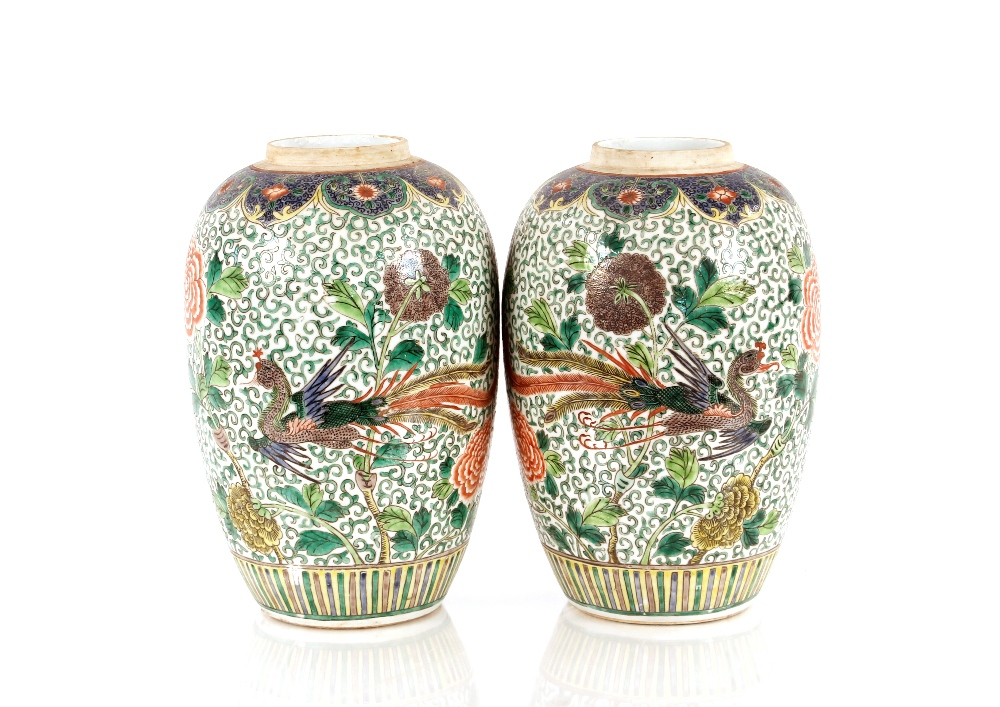 A pair of 19th Century Chinese famille rose vases,of baluster form decorated exotic birds, 34cm