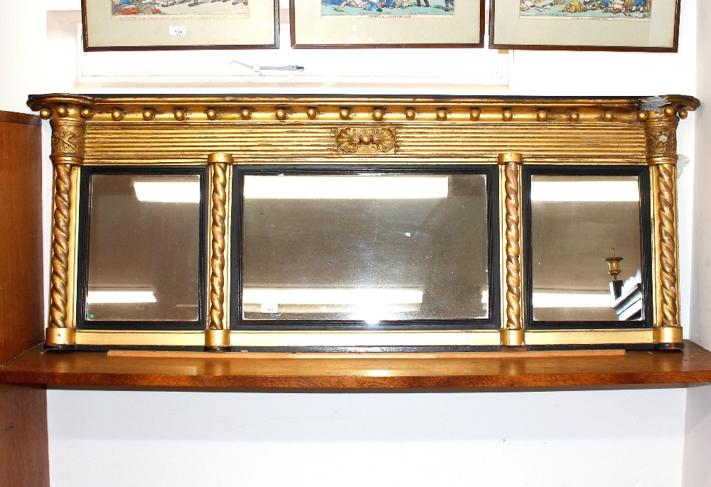 A 19th Century gilt framed triple chimney mirror,with ball decoration to the shaped pediment,