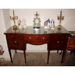 A late 19th / early 20th century mahogany serpentine fronted sideboard,fitted central cutlery