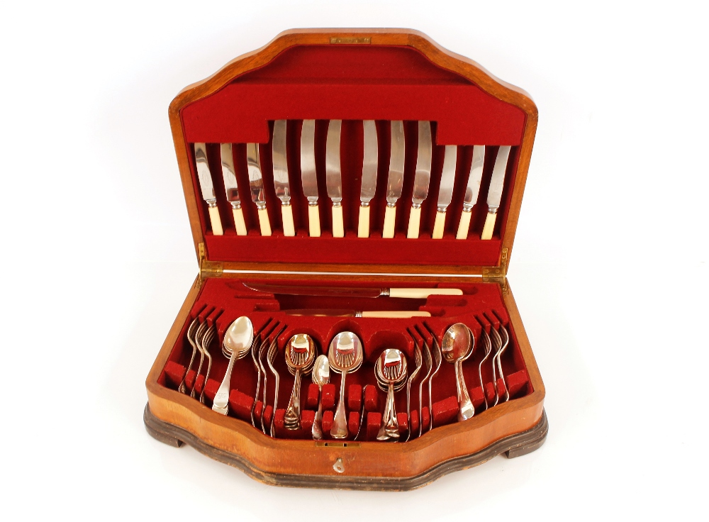 A walnut cutlery case and contents,of silver and plated cutlery etc.