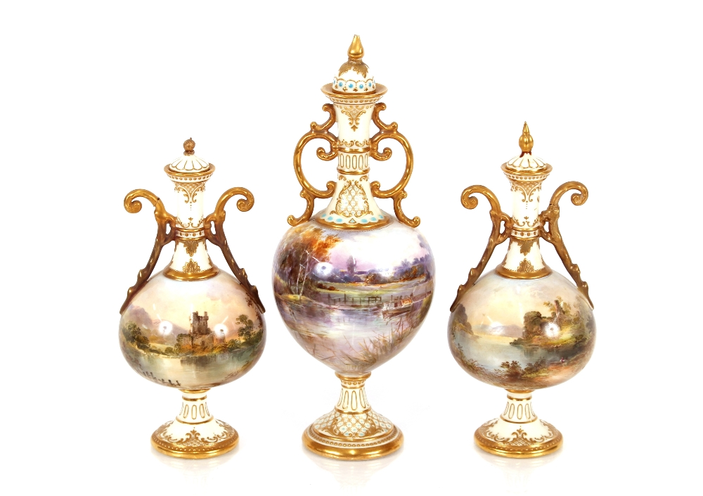 A garniture of Royal Doulton baluster vases and covers,decorated with rural scenes and castle ruins