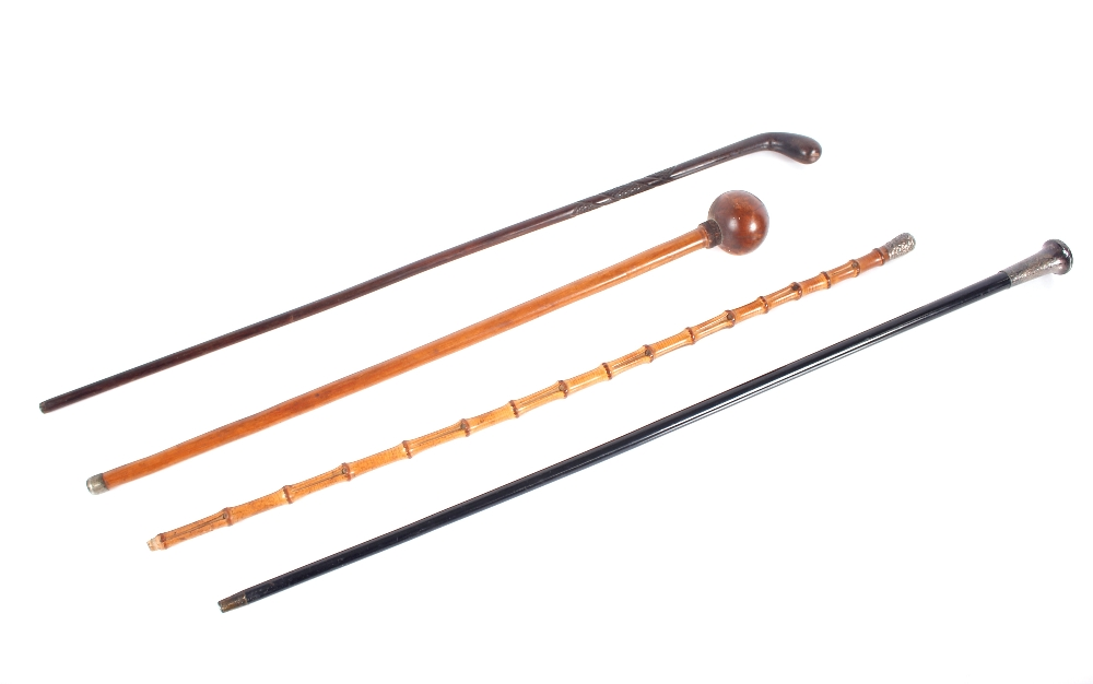 A Zulu club,and three various Victorian and later walking sticks