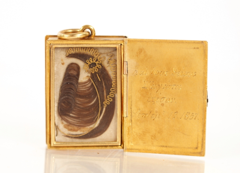A yellow metal and enamel decorated mourning pendant,in the form of a Bible, containing hair - Image 3 of 3