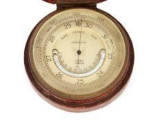 A leather crocodile effect cased pocket barometer,by Asprey of London, 8.5cm dia.
