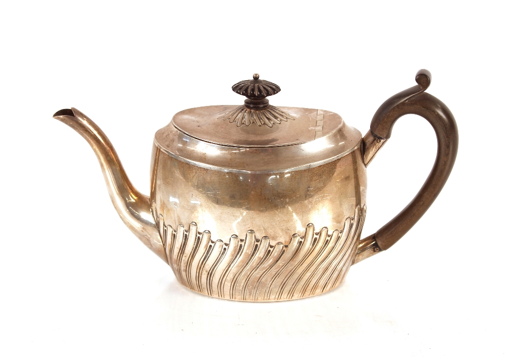 A late Victorian silver teapot,with half fluted body design, black wood handle and lift,